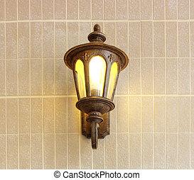 Vintage street lamp on brick wall