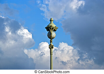 vintage street lamp on cloud sky background