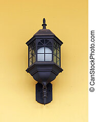 Vintage street lamp on yellow wall