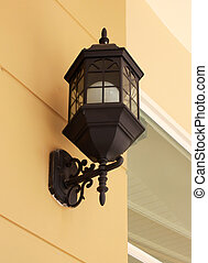 Vintage street lamp on yellow wall