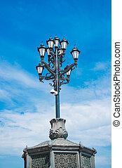 Vintage Street Lantern on Blue Sky Background