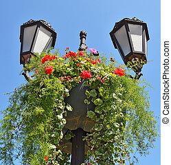 Vintage street light with flowerbed