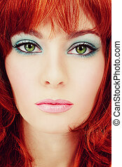 Vintage style close-up portrait of young beautiful green-eyed girl with red hair and stylish makeup