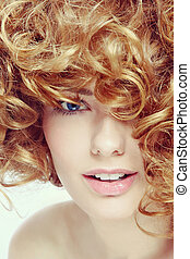 Vintage style close-up portrait of young beautiful happy smiling woman with curly red hair