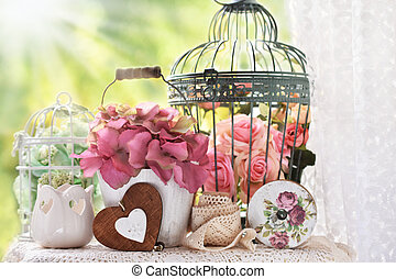 vintage style decoration with flowers and bird cages