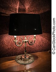 Vintage style lamp on a polished wooden table