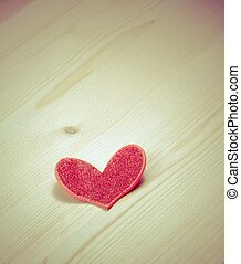 vintage style of decorative red heart on wood background, concept of valentine day