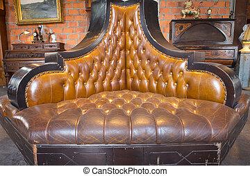 sofa - vintage style of interior decoration the leather sofa