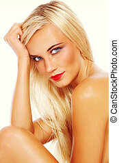Vintage style portrait of young beautiful tanned blond woman with red lipstick