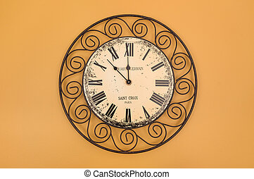 Vintage style round clock on the wall