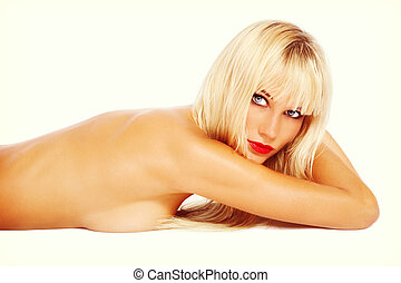 Vintage style shot of young beautiful sexy tanned blond woman with red lipstick