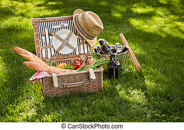 Vintage style summer picnic in a wicker basket
