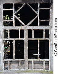 Vintage style window of the burnt house