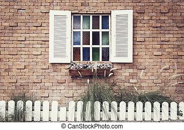 Vintage style Windows on brick wall