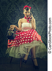 Vintage style - Woman talking with dial phone, in polka dots...