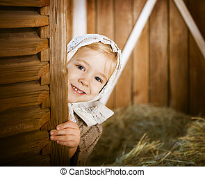 Vintage styled photo of little girl in farm