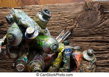 Vintage stylized photo of oil multicolor paint tubes closeup and