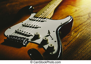 guitar with old wood surface in background.