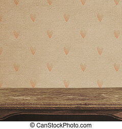 Vintage table on the background of heart pattern wall