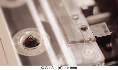 vintage tape start - closeup of vintage cassette magnet tape...