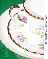 Vintage tea or coffee cup with floral pattern macro shot