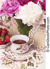 Vintage teacup with spring pi-meson