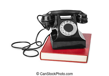Vintage telephone and book