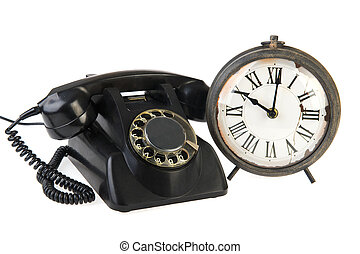 Vintage telephone and clock