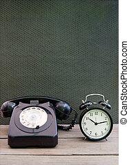 Vintage telephone, clock