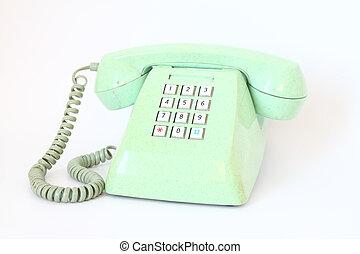 vintage telephone isolated over white background