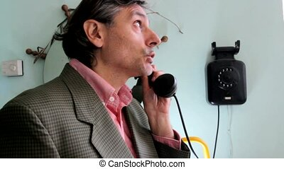 vintage Telephone man - man calling with a vintage telephone