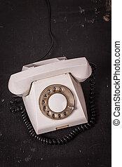 Vintage telephone on a dark background