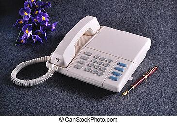 Vintage telephone on granite set with pen