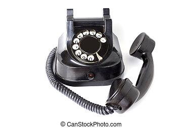 Vintage telephone on white background