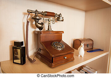 Vintage telephone over retro background with a beautiful statue