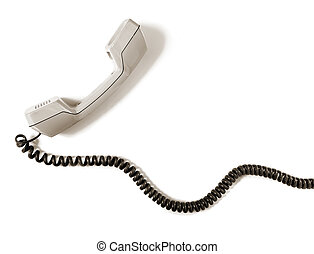 Vintage telephone receiver with cable over white