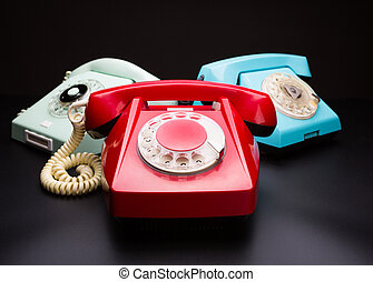 Vintage telephones on white