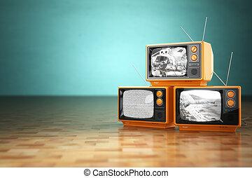 Vintage television concept. Stack of retro tv set on green backg