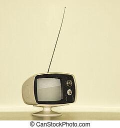 Stilll life of vintage television set with antenna raised.