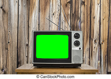 Vintage Television with Old Wood Wall and Chroma Screen