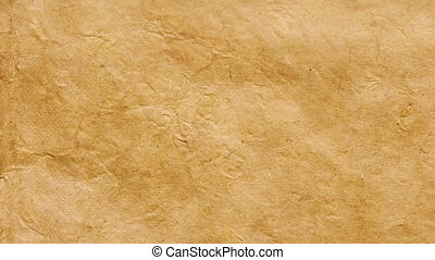 Vintage textured paper background with yellowed aged edges...