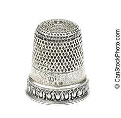 vintage silver thimble on white