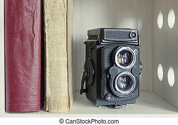 TLR photo camera - vintage TLR photo camera with old books ...
