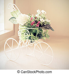 Vintage tone bicycle with artificial flower -  home interior