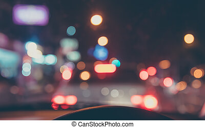 vintage tone blur image of people driving car on night time...