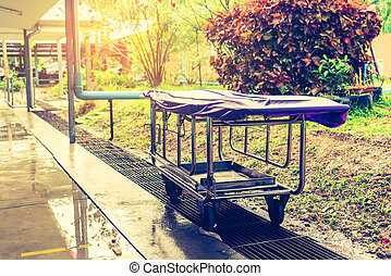 patient bed in hospital outdoor.