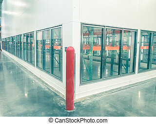 Vintage tone empty and recently remodeled large commercial fridges at whole store in America. Sold out frozen food section