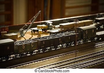 coal train - vintage toned model coal train backlit by ...