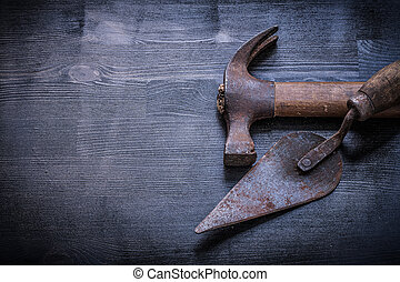 vintage tools claw hammer putty knife on wood board.