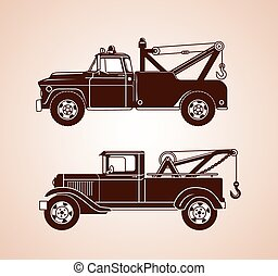 A set of old fashioned tow trucks